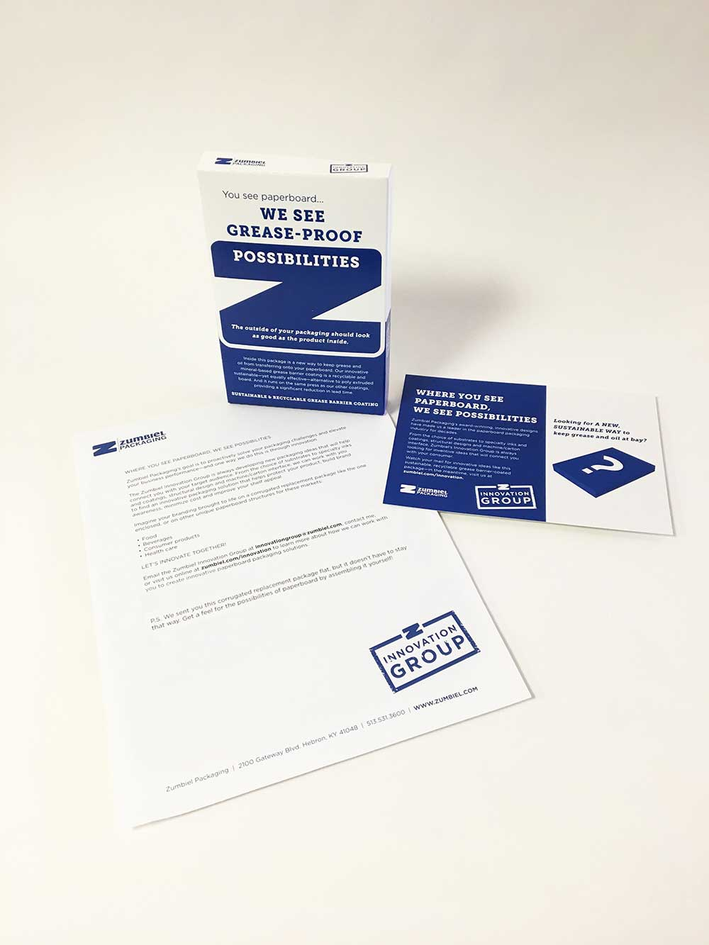 Direct mail campaign with grease-proof box