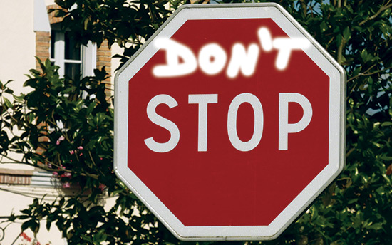 spray painted stop sign